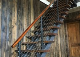 Staircase stringers and guard rail